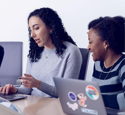 g2-careers-life-two-women-collaborating